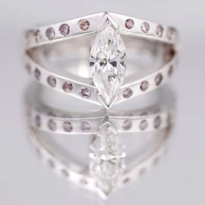 Centre marquise cut Diamond with round brilliant cut natural pink Diamonds in the arms