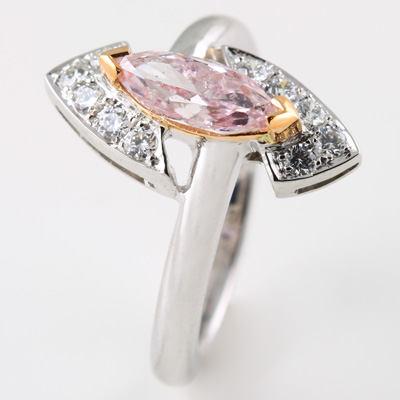 Marquise cut Natural Fancy Pink Diamond with pavé set round brilliant cut White Diamonds
