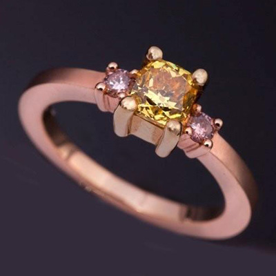 Cushion cut natural Fancy Yellow Diamond with 2 round brilliant cut Fancy Pink Diamonds