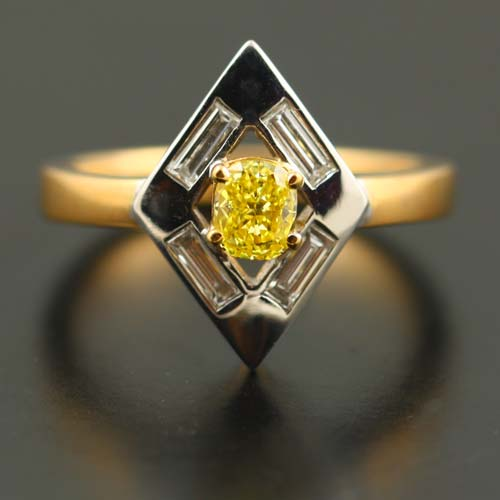 18 K WHITE AND ROSE GOLD, FANCY YELLOW DIAMOND AND BAGUETTE DIAMOND RING