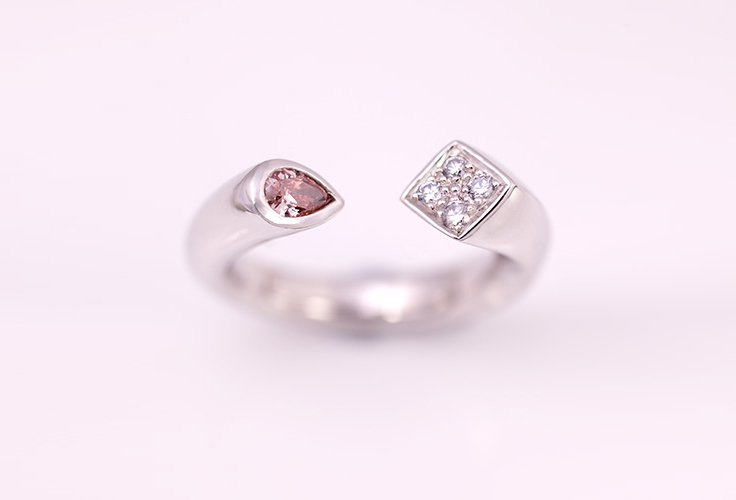 PLATINUM, PINK AND BLUE DIAMOND RING